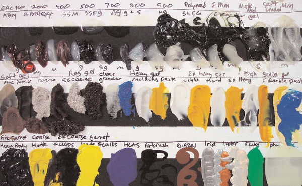 A portion of a Product Review Board showing the alternating black and white bands with samples of GOLDEN Mediums and Gels, both by themselves and mixed with color.