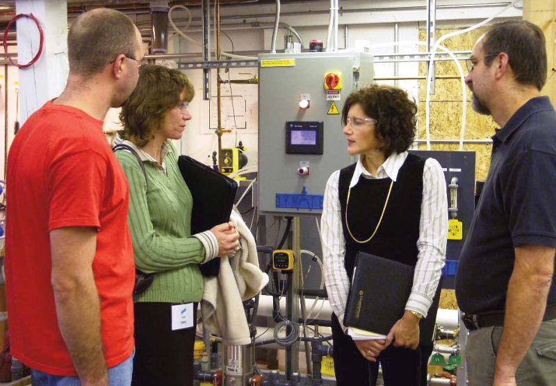 Left to right: GOLDEN Resource Management Technician Tim Knapp; Commerce Chenango President and CEO Maureen Carpenter; Linda Jacobs, with the Environmental Services Unit of Empire State Development and GOLDEN Facility Engineer Fran Reale discuss the benefits of the new Reverse Osmosis System.