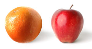 Apple and orange on a white background