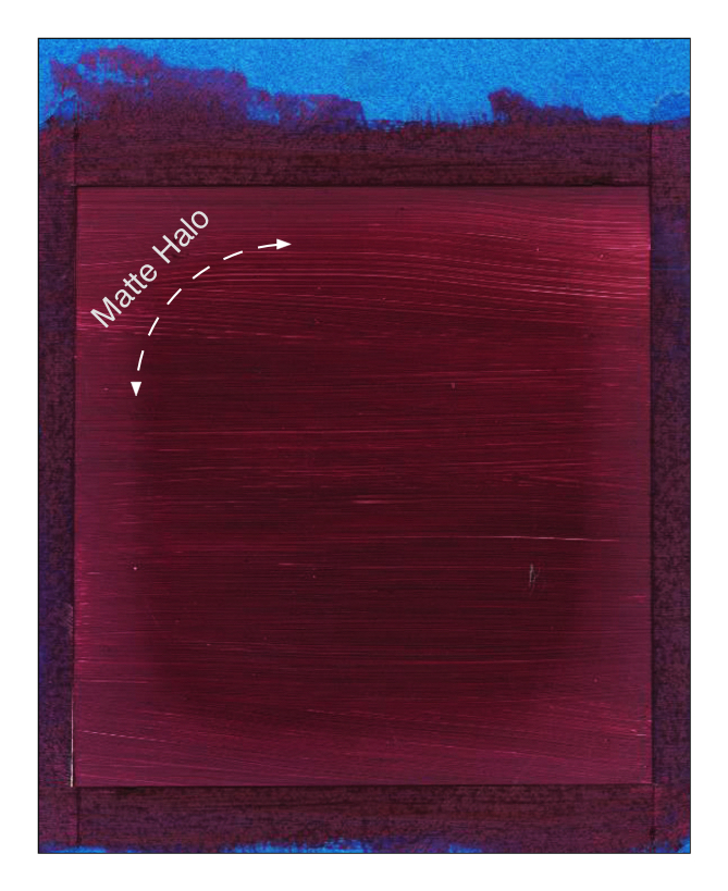 Example of a paint-out of Williamsburg Ultramarine Pink where a matte halo developed after being allowed to dry with the painter's tape in place.