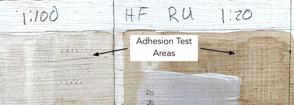 Cross hatch adhesion tests of High Flow Raw Umber thinned 1:100 and 1:20 with water.
